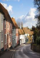 quiet essex village street and houses in winter sun